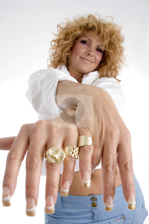 Woman showing her finger rings stock photo, Woman showing her finger rings on an isolated background by Imagery Majestic