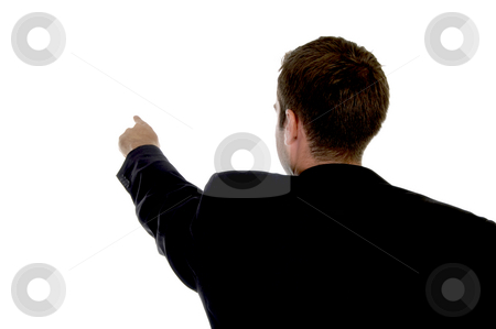 Young businessman showing finger stock photo, Young businessman showing finger with white background by Imagery Majestic