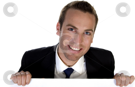 Confident businessman holding a white board stock photo, Confident businessman holding  white board with white background by Imagery Majestic