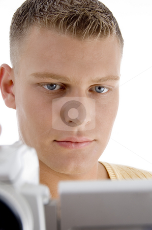 Young man looking videos stock photo, Young man looking videos on an isolated white background by Imagery Majestic