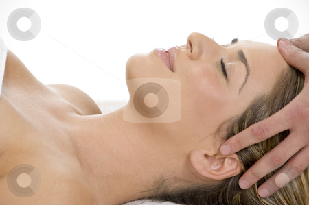 Portrait of lady getting head massage stock photo, Portrait of lady getting head massage by Imagery Majestic
