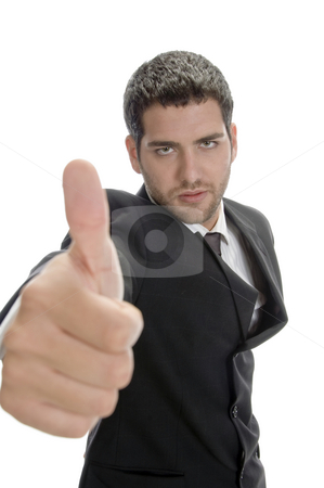 Young successful businessman stock photo, Young successful businessman showing thumbs up by Imagery Majestic