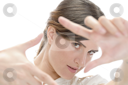 Woman showing framing hand gesture stock photo, Woman showing framing hand gesture on an isolated background by Imagery Majestic