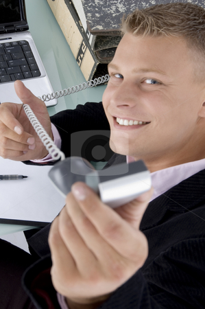 Executive showing phone  stock photo, Executive showing phone on an isolated background by Imagery Majestic