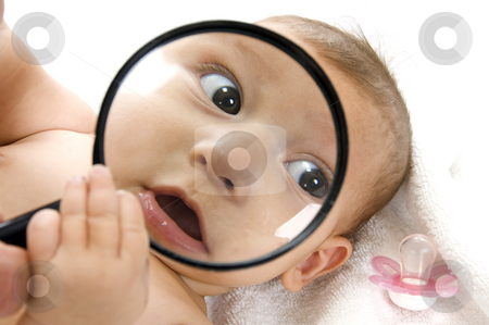 Baby's magnified face stock photo, Baby's magnified face isolated on white background by Imagery Majestic