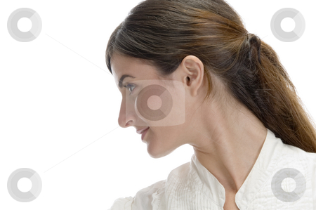 Charming lady looking side stock photo, Charming lady looking side on an isolated white background by Imagery Majestic