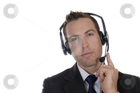 Thinking businessman with headphone stock photo, Thinking businessman with headphone on an isolated background by Imagery Majestic
