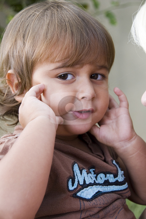 Cute little boy posing stock photo, Cute little boy posing with hands on his cheeks by Imagery Majestic