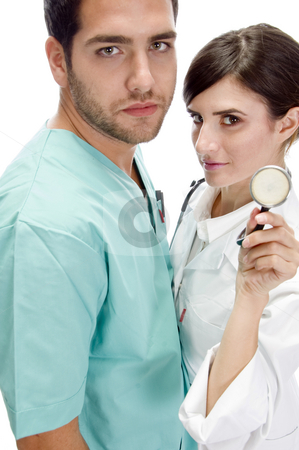 Nurse standing with patient showing stethoscope stock photo, Nurse standing with patient showing stethoscope with white background by Imagery Majestic