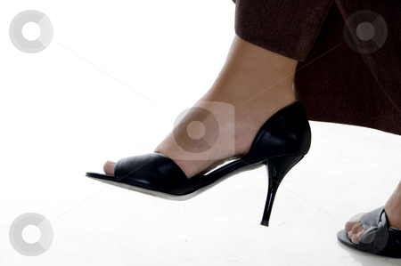 Crossed legs of corporate lady stock photo, Crossed legs of corporate lady on an isolated background by Imagery Majestic
