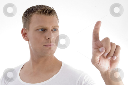 Handsome young male pointing stock photo, Handsome young male pointing against white background by Imagery Majestic