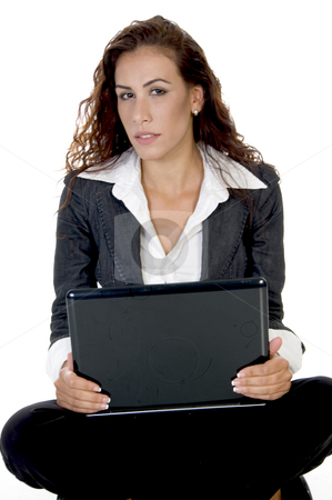 Female holding laptop stock photo, Female holding laptop  on an isolated background by Imagery Majestic