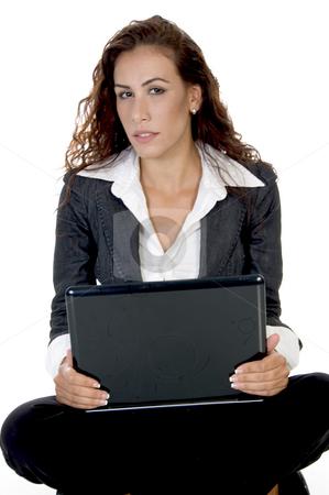 Female holding laptop stock photo, Female holding laptop  on an isolated background by Imagery Majestic