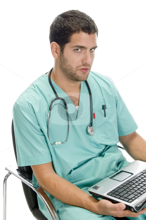 Sitting man looking you with laptop stock photo, Sitting man looking you with laptop on an isolated background by Imagery Majestic