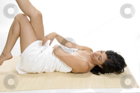 Sexy woman relaxing stock photo, Sexy woman relaxing against white background by Imagery Majestic