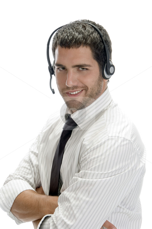 Smiling businessman posing with headset stock photo, Smiling businessman posing with headset against white background by Imagery Majestic