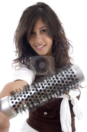 Female showing her roller comb stock photo, Female showing her roller comb on an isolated white background by Imagery Majestic
