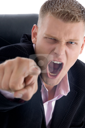 Indicating shouting businessman stock photo, Indicating shouting businessman on an isolated white background by Imagery Majestic