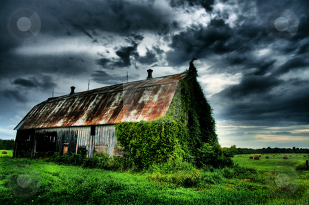 Summers Bounty stock photo, Barn field and sky on a summers eve by R Deron