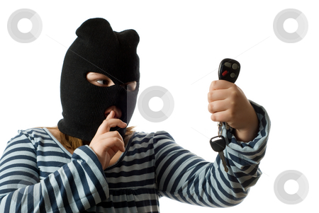 Joyride stock photo, Concept image of a young child stealing some car keys to go for a joyride, isolated against a white background by Richard Nelson