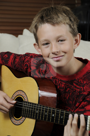 Boy Musician stock photo, Young Man Playing guitar by Timothy OLeary