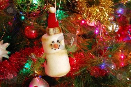 Christmas Ornament stock photo, A Christmas tree featuring a snowman ornament by Crystal Srock