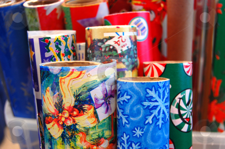 Rolls of Christmas Wrapping Paper stock photo, A variety of tubes or rolls of colorful Christmas wrapping paper. by Crystal Srock