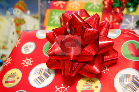 Christmas Present stock photo, A bright red Christmas present with red bow by Crystal Srock