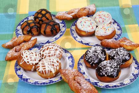 Doughnut stock photo, Fresh doughnuts and pastry straws  as  background by Jolanta Dabrowska
