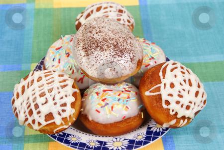 Doughnut stock photo, Fresh  doughnuts on a plate  as  background by Jolanta Dabrowska