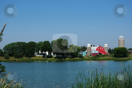 Barn and farm scenic stock photo, A farm home, barn and related buildings nestled in the corner of a central Minnesota farm offers a scenic view for passersby. by Dennis Thomsen
