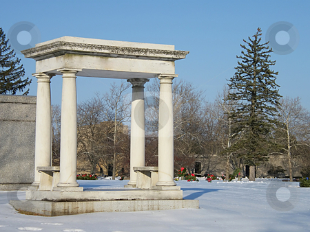Grave Monument stock photo, Grave Monument in a Cemetery in the Winter. by Dazz Lee Photography