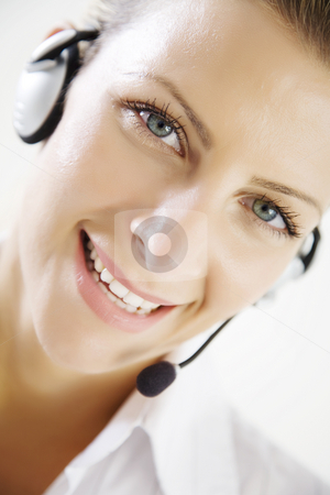Customer service stock photo, Closeup of smiling phone operator by Liv Friis-Larsen