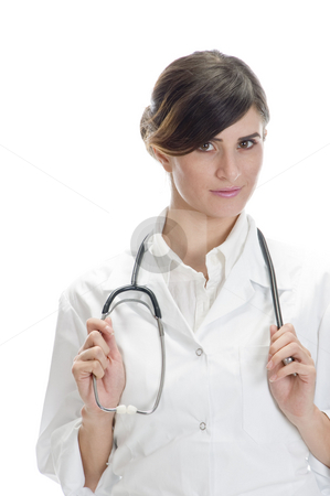 Lady doctor holding stethoscope stock photo, Lady doctor holding stethoscope against white background by Imagery Majestic