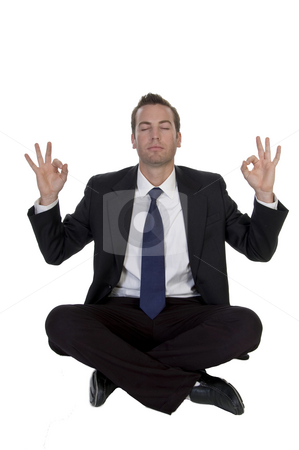 Sitting businessman showing hand gesture stock photo, Sitting businessman showing hand gesture against white background by Imagery Majestic