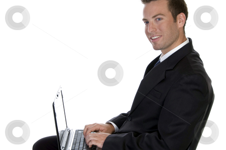 Successful businessman with laptop stock photo, Successful businessman with laptop against white background by Imagery Majestic