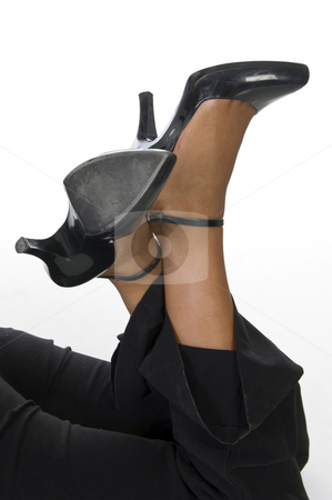 Sandals in legs stock photo, Sandals in legs  on an isolated background by Imagery Majestic