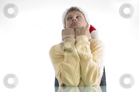 Sad man wearing christmas hat stock photo, Sad man wearing christmas hat with white background by Imagery Majestic