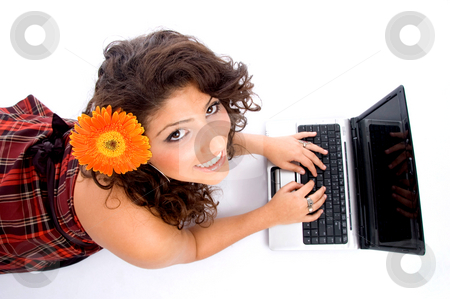 Laying woman with laptop stock photo, Laying woman with laptop on an isolated background by Imagery Majestic