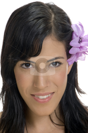 Portrait of smiling woman with flower in her hair stock photo, Portrait of smiling woman with flower in her hair by Imagery Majestic