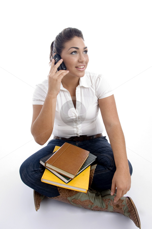 Young student busy on phone call stock photo, Young student busy on phone call against white background by Imagery Majestic