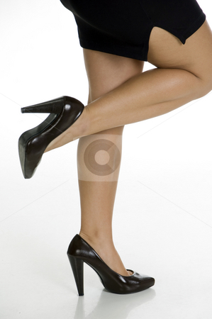 Woman standing on one leg stock photo, Woman standing on one leg on an isolated white background by Imagery Majestic