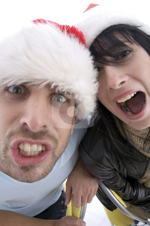 Pretty couple with chritsmas hat  stock photo, Pretty couple with chritsmas hat on an isolated white backgound by Imagery Majestic