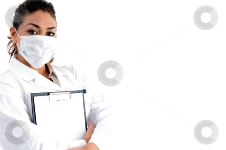 Doctor with mask on her mouth and writing board stock photo, Doctor with mask on her mouth and writing board on an isolated background by Imagery Majestic