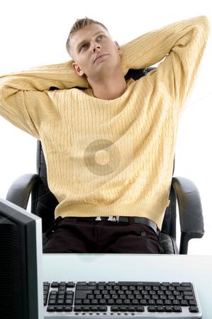 Executive sitting idle stock photo, Executive sitting idle against white background by Imagery Majestic