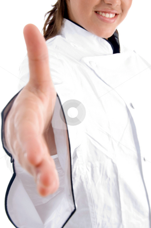 Chef offering hand shake stock photo, Chef offering hand shake against white background by Imagery Majestic