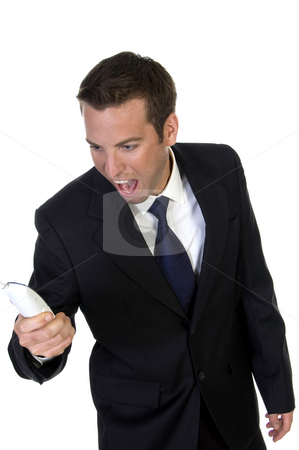 Man shouting on his mobile phone stock photo, Man shouting on his mobile phone on an isolated  white background by Imagery Majestic
