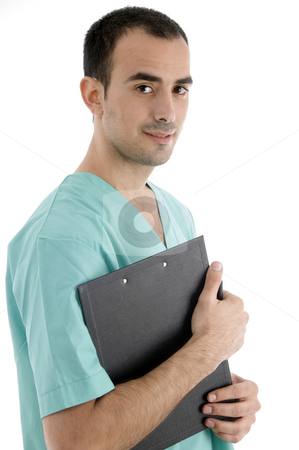 Side pose of doctor with writing pad stock photo, Side pose of doctor with writing pad on an isolated white background by Imagery Majestic