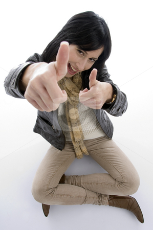 Sitting woman showing approval sign stock photo, Sitting woman showing approval sign against white background by Imagery Majestic