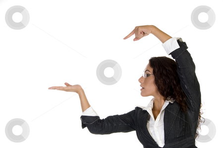 Lady pointing on palm stock photo, Lady pointing on palm on an isolated background by Imagery Majestic